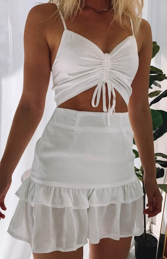 33179440f04 Look white hot on your next night out in the Zahra Ruched Dress in White!