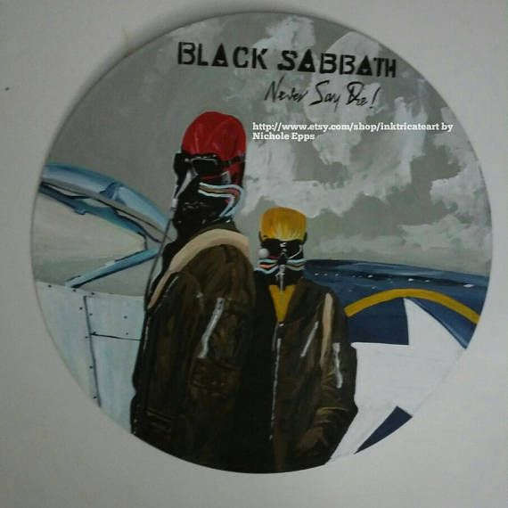 Check out this item in my Etsy shop https://www.etsy.com/listing/535378695/black-sabbath-never-say-die-album-art
