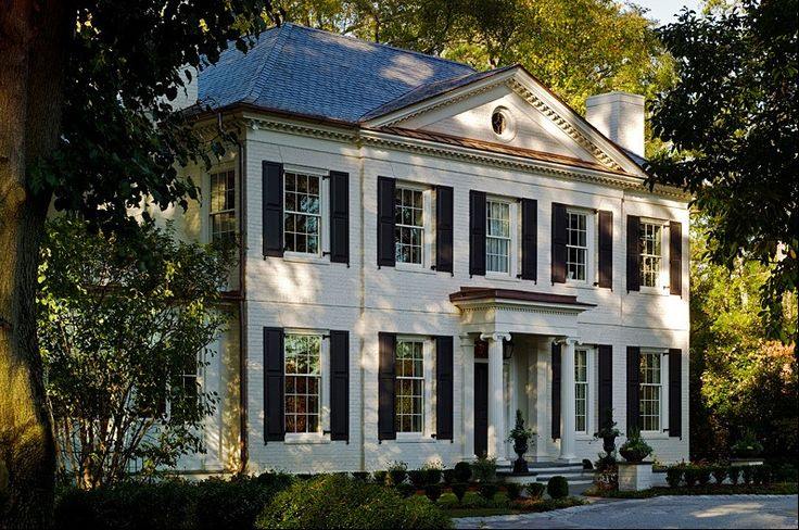 Simply Spectacular Tripartite Pedimented Home With Beautiful Black Shutters And Ionic Column
