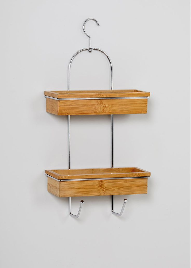 £15 Matalan  Add extra detail to your bathroom with this bamboo and metal shower caddy. Featuring two bamboo trays, metal over door hook and two additional hooks. Perfect...