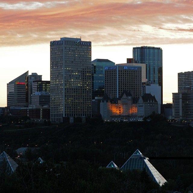 "@edmontonjournal's photo: ""The setting sun and a rain cloud hover over downtown Edmonton on June 26, 2014. Photo by John Lucas / Edmonton Journal #yeg #edmonton #latergram #sky #nightsky #sunset #alberta #canada"""