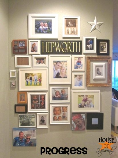 hallway photo gallery  I like the family name in the middle. would need to be more uniform in terms of the frames though...