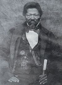 Adam Kok III - Griqua Captain - 1848-The Griqua -Afrikaans -Griekwa, sometimes incorrectly called Korana) are a subgroup of South Africa's heterogeneous and multiracial Coloured people. However, they have a unique origin in the early history of the Cape Colony.  Similar to another Afrikaans-speaking group at the time, the Trekboers, they originally populated the frontiers of the infant Cape Colony, their semi-nomadic society mobilized into commandos of mounted gunmen. Also like the Boers…