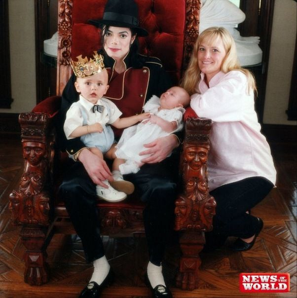 Michael Jackson and his wife Debbie Rowe with their 1-year-old son Prince Michael and newborn daughter Paris in 1998 at their home Neverland.