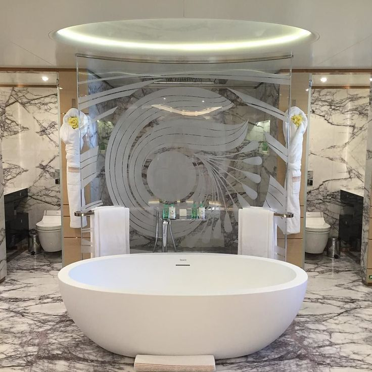 Yes .... A bath... That's large enough for two.....For him and her....Including the loos. And yes it's on a yacht..... #interior #marble #glass#stone #interiordesign #superyacht #style#yachtcharter #plentyofspace #myba #genoa #italy #boat #design #luxury#travel#lifestyle by the_yacht_girl