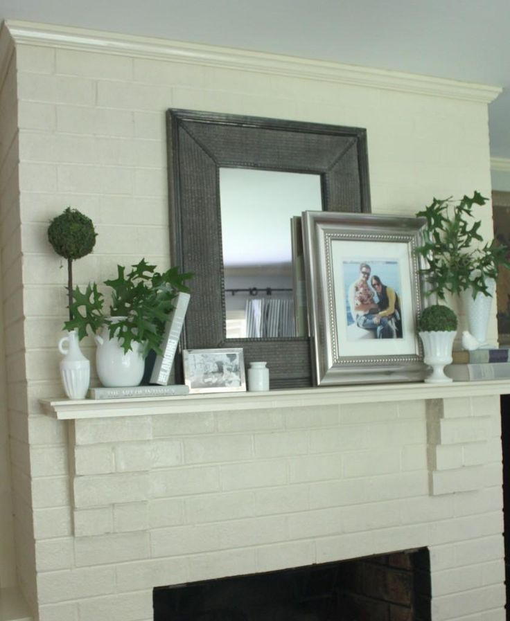 simplicity of the mantle decor layers of frames plants candles lighting - Decor For Mantels
