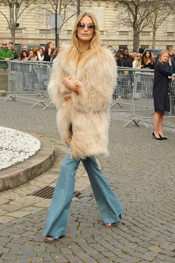 Poppy Delevingne in a shaggy fur coat.