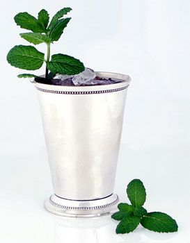 May 30 is Mint Julep Day! 1 scant oz minted simple syrup, 2 oz bourbon, ice and a fresh mint sprig for garnish   Read More http://www.epicurious.com/articlesguides/drinking/cocktails/mint_julep/recipes/food/views/Mint-Julep-234757#ixzz2Uml6niK8         Mint Julep Photo  at Epicurious.com