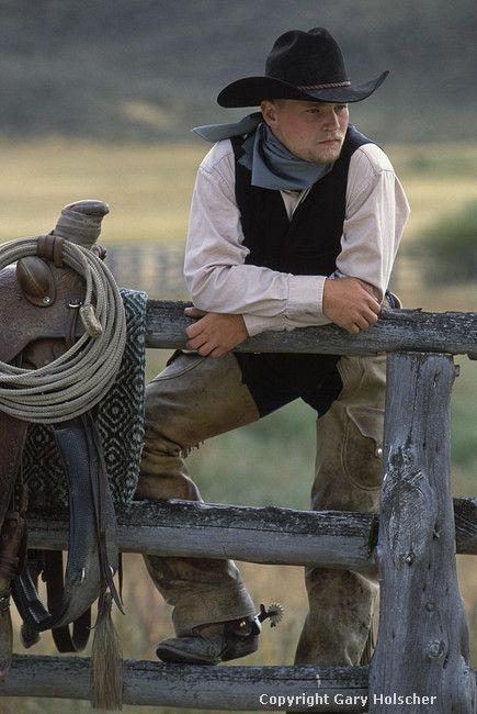Cowboy on a fence