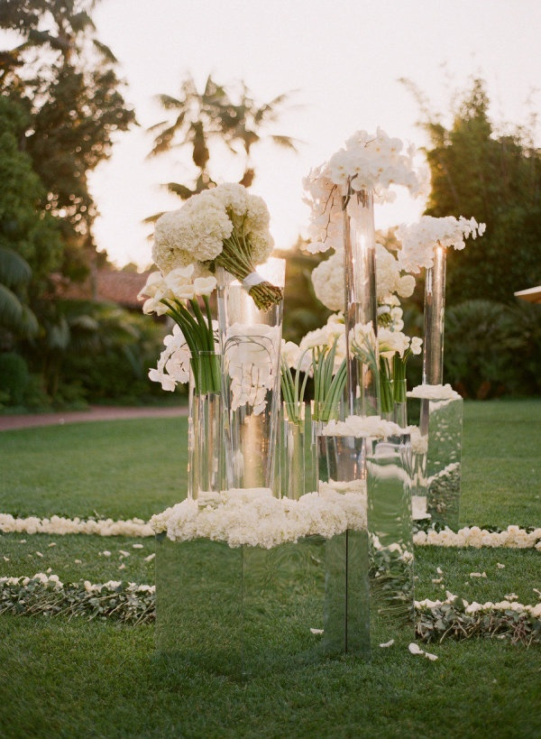Mirrored stands were a breathtaking touch to bold, modern bouquets at an outdoor @Mandy Bryant Bryant Dewey Seasons Resort the Biltmore Santa Barbara celebration.