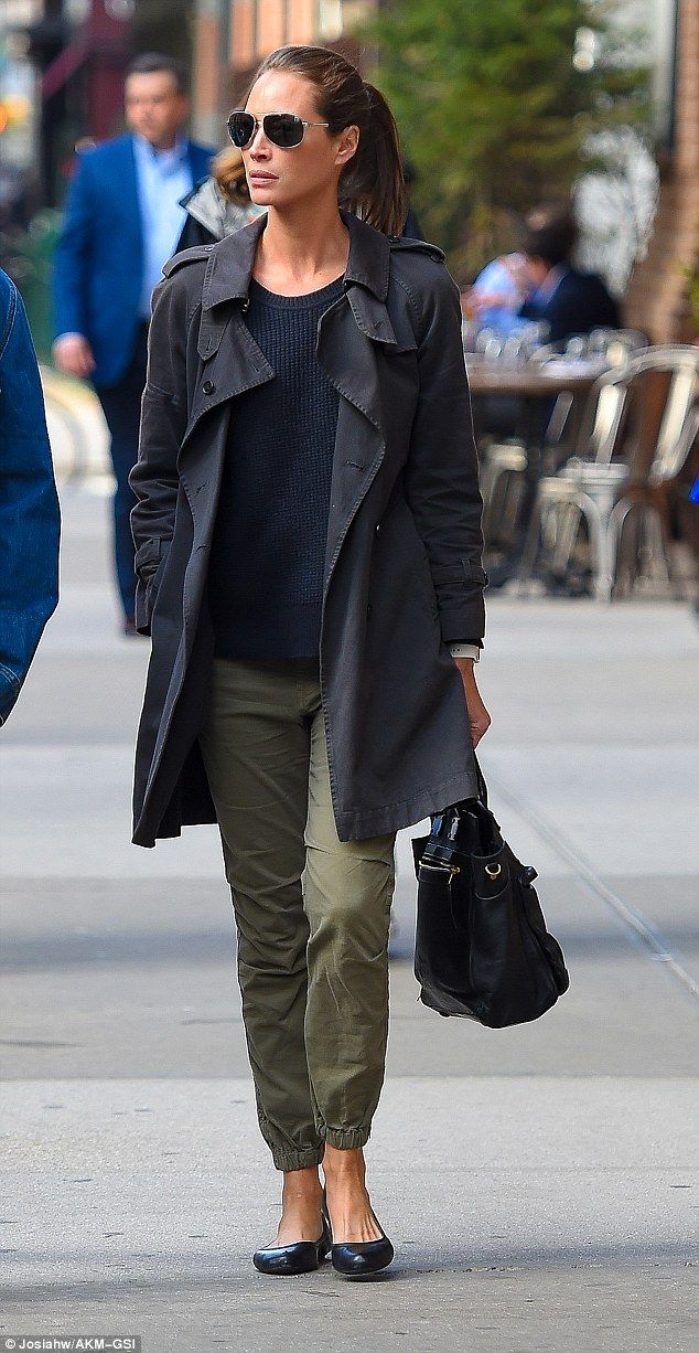 Casual-chic: Supermodel Christy cut a stylish figure in a ribbed navy blue sweater, green ...