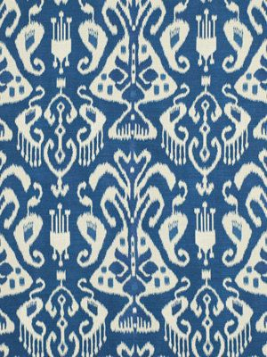 A woven ikat upholstery fabric in peacock blue and ivory. This mid-weight durable fabric is suitable for all furniture upholstery. See other