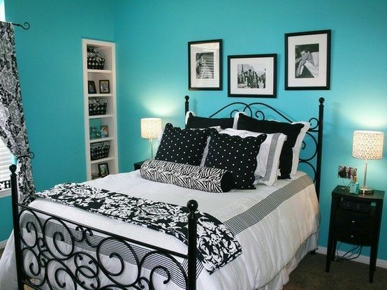 Black and white bedroom is punchy against colored walls