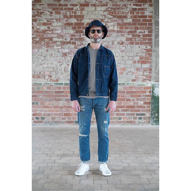 #orslow #AW15 Delivery 1 - pictured is the Heather Navy US Navy Hat, Indigo One Wash Type 1 Blouson, Indigo Pin Stripe V-Neck T-Shirt, Damage Wash 107 Slim Fit Jean along with #oliverpeoples #byredo Matte Black/Green Sunglasses and #converse White  JP Signature Ox.