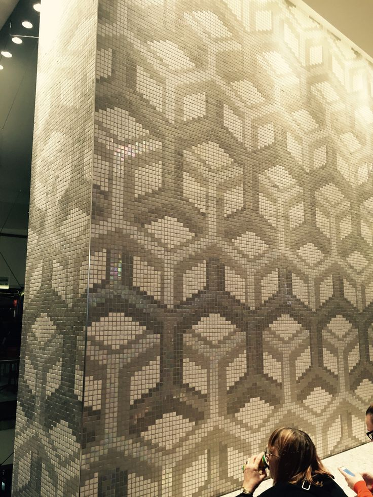 Photo 2: Mosaic tiled wall with hexagonal pattern that is repeated throughout the casino