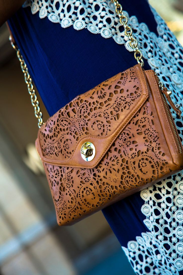 Looked for this bag everywhere. It's sold out, but it's the Sole Society Janie laser cut clutch in color luggage.