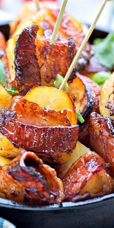 Bacon Wrapped Potatoes ~ Potato Pieces, tossed in BBQ Sauce and Wrapped in Smoked Bacon, then Roasted to Crispy Golden Perfection.
