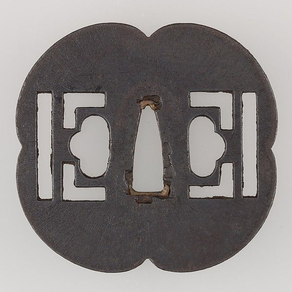 Sword Guard (Tsuba) Date: 18th century Culture: Japanese Medium: Iron, copper Dimensions: H. 3 in. (7.6 cm); W. 3 3/16 in. (8.1 cm); thickness 3/16 in. (0.5 cm); Wt. 4.8 oz. (136.1 g) Classification: Sword Furniture-Tsuba Credit Line: Funds from various donors, 1946