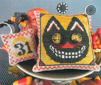 love the buttons for eyes on this cross stitch tiny pillow Halloween ornament