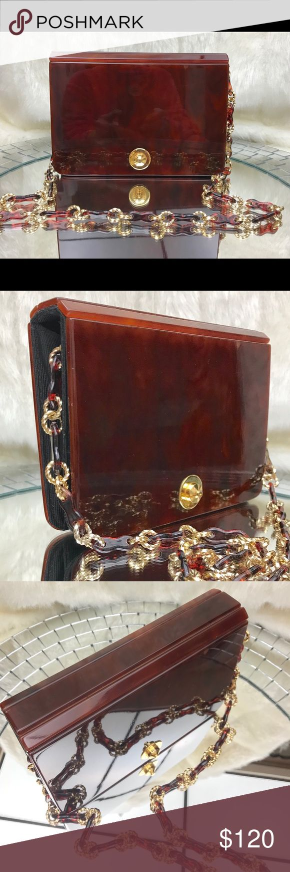 🎁🎄MCM Tano of Madrid Lucite Clutch Shoulder Bag 🎁 Gift Yourself with this RARE, Magnificent and stunning lucite bag in deep amber tortoise shell finish. Mid century modern. Beveled top hing. Accordion style interior.  Excellent vintage condition. Gold tone hardware on front with Lucite and gold tone removable chain. Snap front closure.  Inner zipper pull is rough feeling and exterior finish has very minor scratches that can be seen up close if you're looking for them. Priced accordingly…