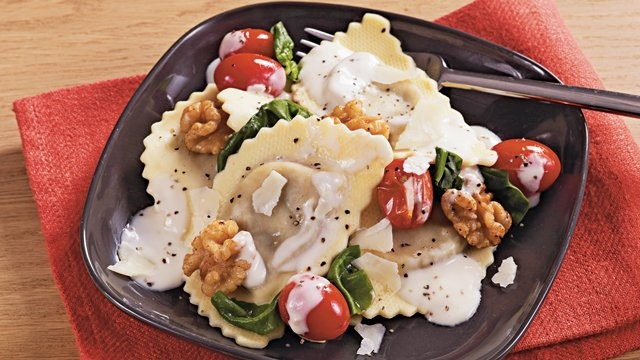 Slow Cooker Wild Mushroom Pasta Alfredo with Walnuts - Mushroom agnolotti pasta, Alfredo sauce, tomatoes are layered in slow cooker for cheesy Italian dinner.