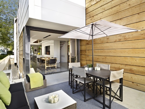 Scaled down outdoor dining with umbrella shade - LG House - Exterior modern patio