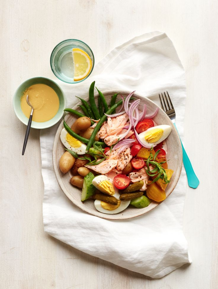 This warm salmon salad niçoise is spring on a plate. And it's sure to satisfy with its big chunks of salmon, egg, potatoes, and veggies, topped with a rich mustardy dressing. Get this and more great recipes in our free digital magazine.