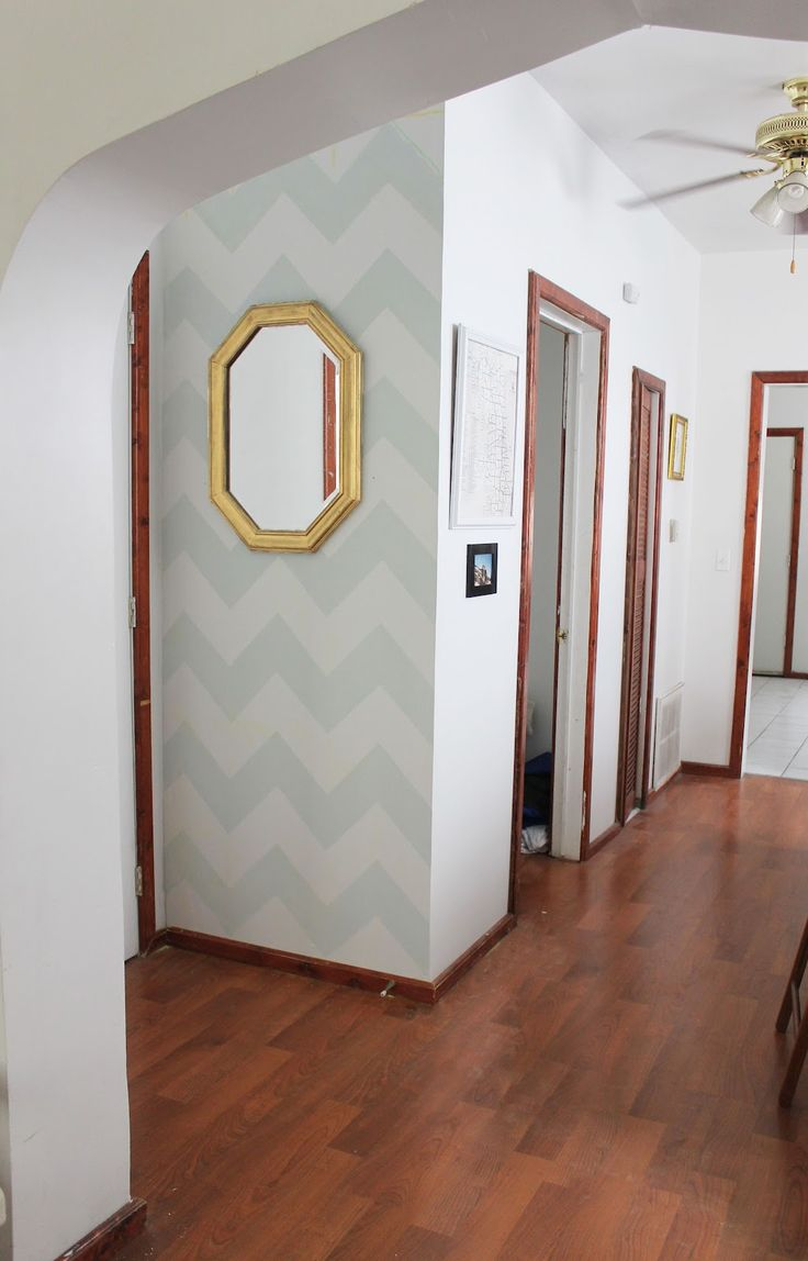 """Really easy chevron wall tutorial. This girl is hilarious. She used the cardboard from an old conair curler box to trace the lines and says """"If you don't have the top to a Conair MORE BIG CURLS box, your wall will probably be totally fucked up and awful. Sorry. You must use this particular box."""" Haha"""