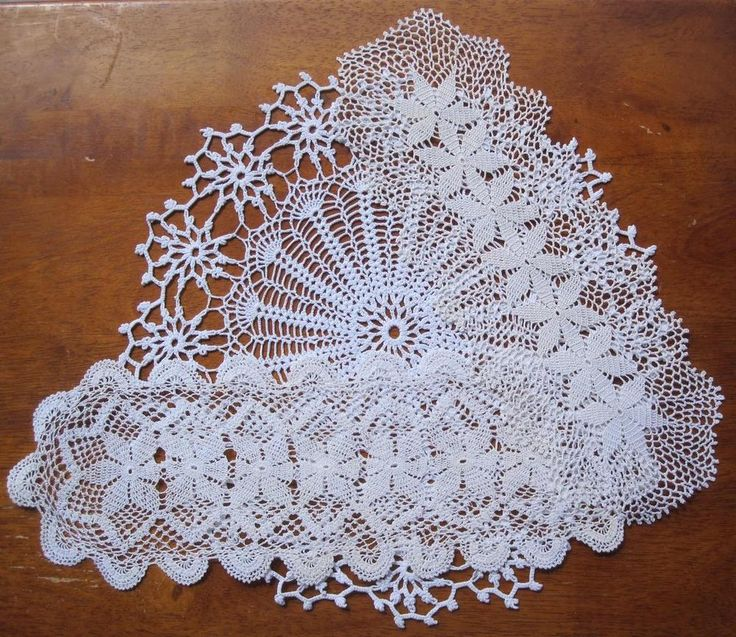 Three Vintage Hand Filet Lace/Crochet DOILIES 34cms x 12cms 30cms x 12cms 30 cms Diameter Colour is bone or vintage white.  In very good vintage condition as the pictures show *Washed *Starched *Ironed  so comes to you ready to use.