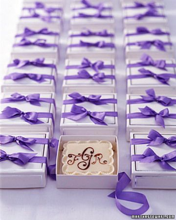 Mini monogrammed groom's cakes go home in individual favor boxes