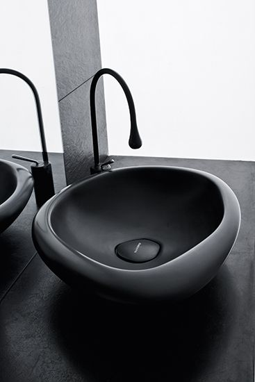 An unmistakable design for our #Sasso basin, available in both black and white version. #MastellaDesign #basin #washbasin #blackandwhite #bathdesign #bathroom #design