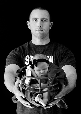 Football coach meets baby...from a recent newborn session by @Carissa from {Carissa Miss} Wemmie :)