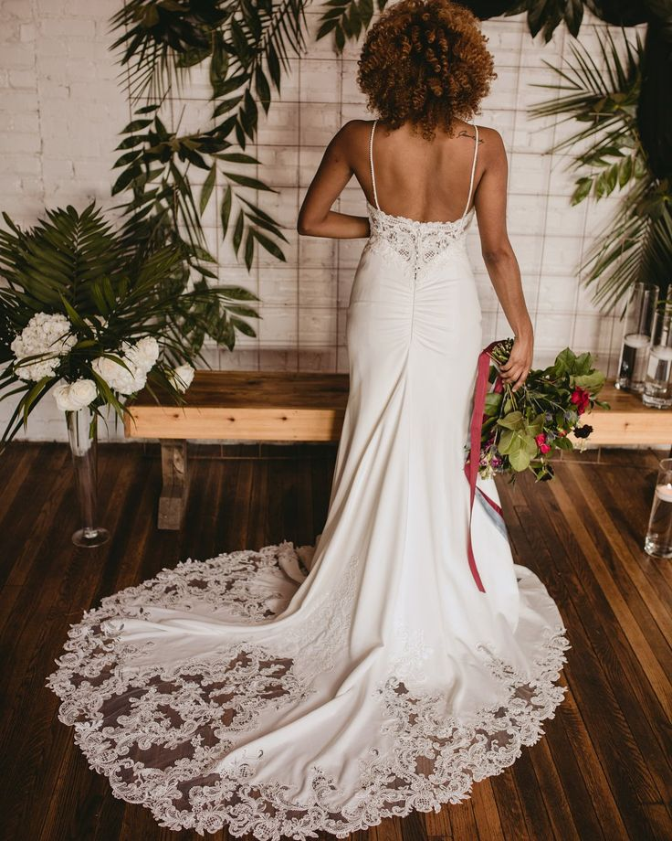 Details on Zoey train by Maggie Sottero! Boutique @urbansetbride / styling by Ciera of @wglevents / florals by @amanda.burnette // menswear from @blissbridalconsignment // photography @carlyromeoandco