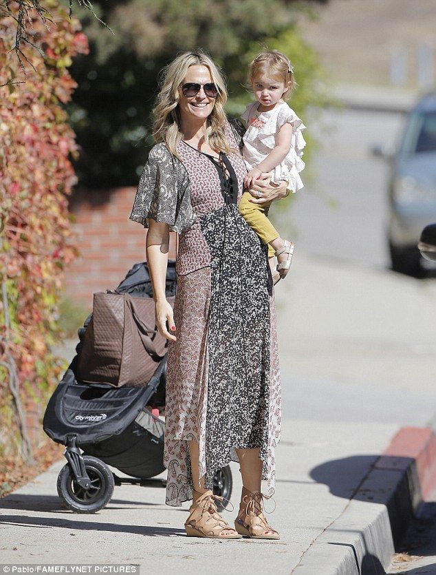 Out on the town:Molly Sims stepped out in a flattering brocade print dress on Thursday in Brentwood