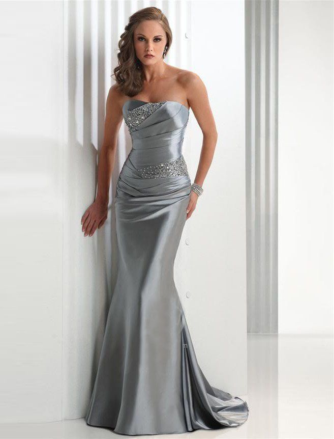 "Start out searching for your perfect long maxi strapless silver prom dress by flipping through magazines and online to see what kind of dress you are most attracted to. Then hit the stores with an idea in mind of what you are looking for. Try on as many dresses as you can; your idea of the ""perfect dress"" may not be as well suited for you as another style. Don't limit yourself."