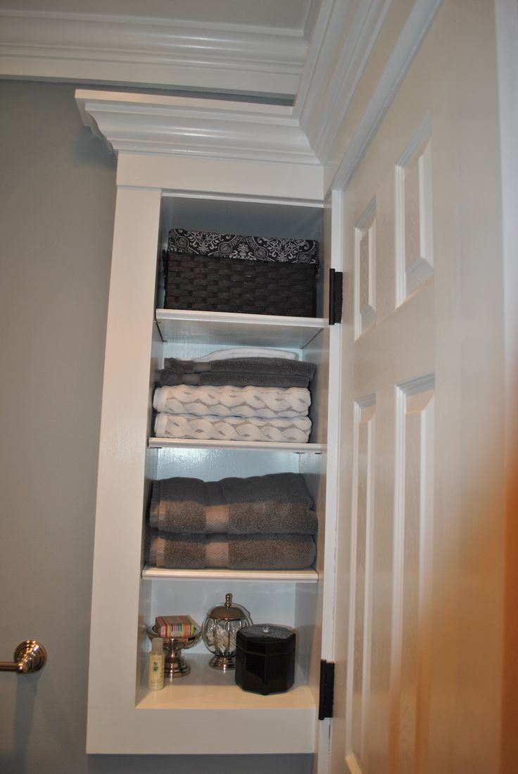 Custom storage built in behind door small bathroom for Small cupboard designs