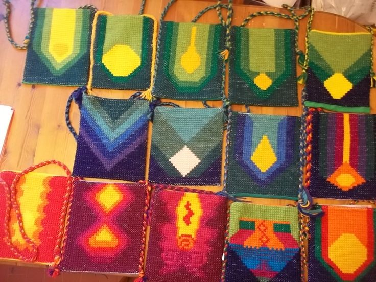 Love these designs on cross stitched pouches
