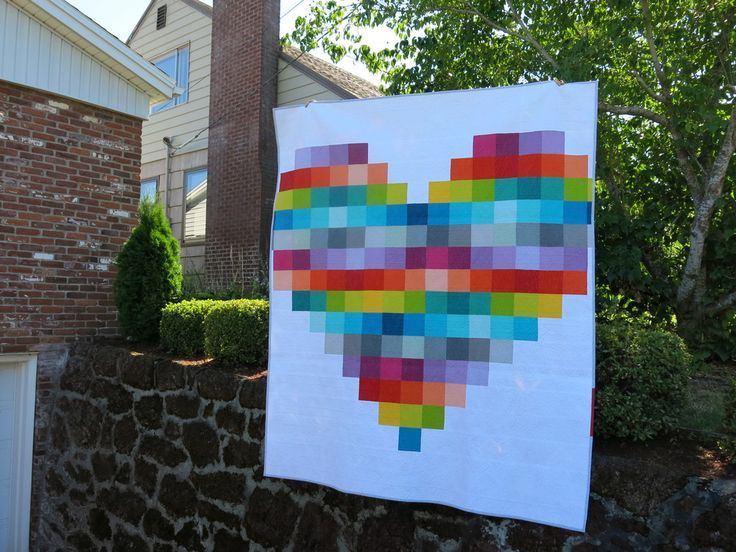 """I used large-scale pixelated hearts like these on the backs of several  quilts that I made during 2014, and I thought it would be fun to share how  you can make one too.  The Pixel Heart pattern includesinstructions for making Large (28-1/2"""" x  24"""") and Gigantic (85-1/2"""" x 72"""") hearts. Both sizes can be made with  scraps and/or 5"""" x 5"""" charm squares. The Large version uses 2"""" squares, 4  of which can be cut from a single charm square. The Gigantic version uses  5"""" x 5"""" squares."""