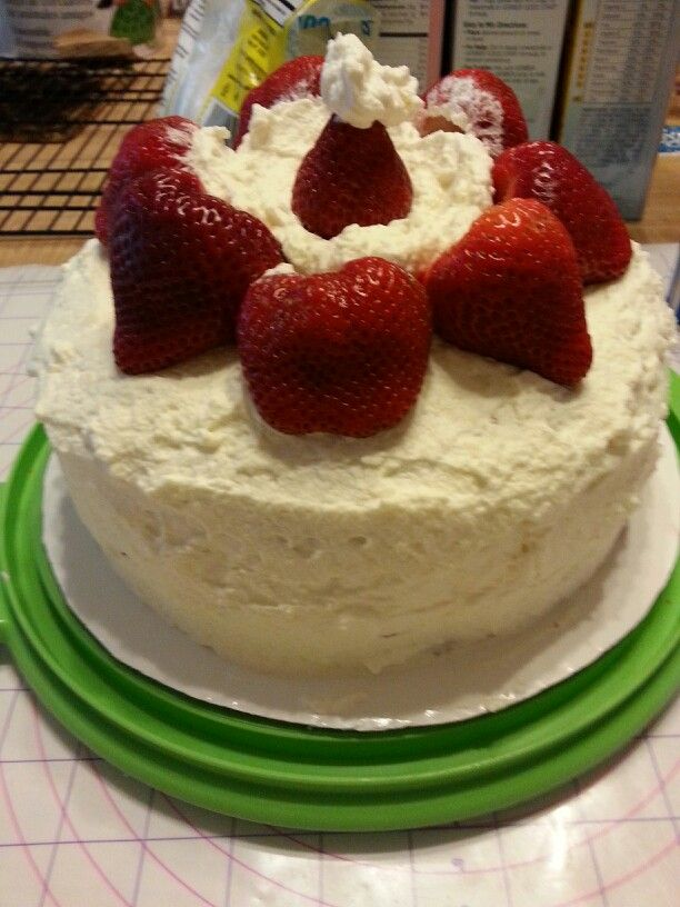 ... . White cake with sliced berries and homemade whipped cream frosting