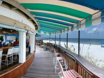 "Sunset Beach Bar at Naples Beach Hotel - Voted the ""Best Place to Catch a Southwest Florida Sunset"" by locals and named the ""Best Beachfront Bar in Naples"" by the Travel Channel."
