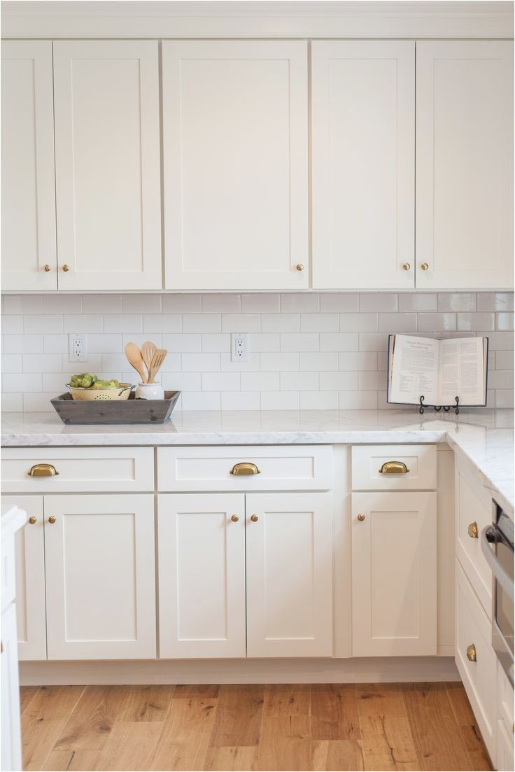 Aged Brass Hardware Kitchens Pinterest From Kitchen Cabinet Hardware In This Modern White Kitchen Cabinets Shaker Style Kitchen Cabinets Kitchen Cabinet Styles