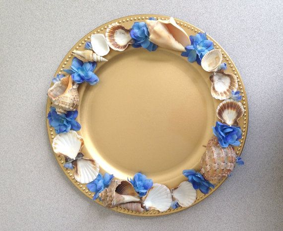 Charger plate beach theme gold seashells centerpiece