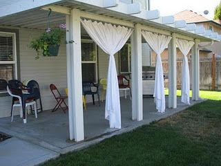 patio under deck ideas, curtains...I want pergolas all along the sides of  my deck and we could have these curtains so then we could close off the  deck