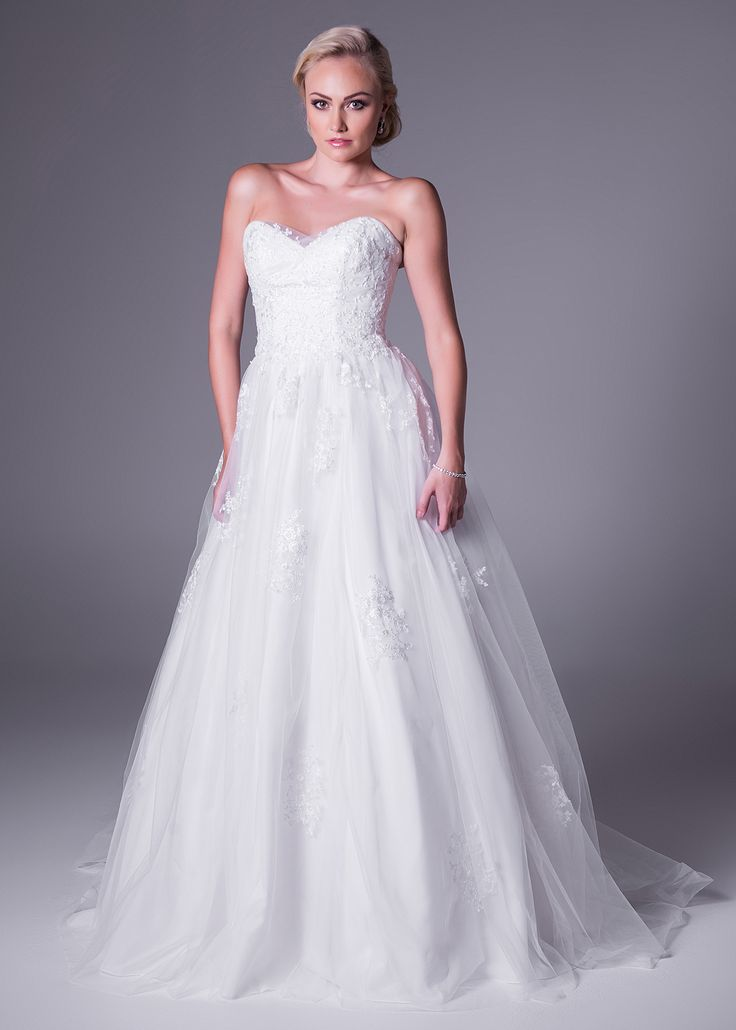Sweetheart neckline covered with tulle and lace wedding gown.