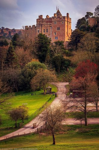 Dunster Castle, Dunster, Somerset, England. A beautiful village and castle, and good pub. Do a candlelit evening in winter. And steam train rides through the year.