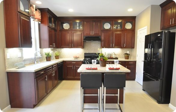 dark oak wood kitchen cabinets- that's what my fridge looks like anyway