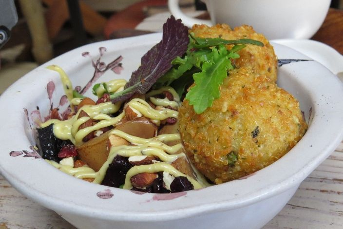 Schoon De Companje, Stellenbosch - Quinoa Fritter Salad (mixed baby leaves, pickled pear, almond & cranberry salsa with a Parmesan dressing
