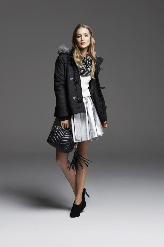 Duffle jacket and metallic silver skirt