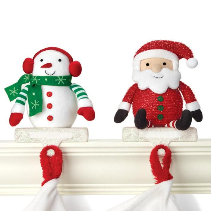 """AVON EXCLUSIVE Hang your stockings by the chimney with care! These unique stocking holders feature color-changing LED lights and include a space for personalization. Uses 3 AAA batteries (not included). Each, 7"""" H x 5"""" W x 3"""" D. Plastic, fabric, metal. Imported."""
