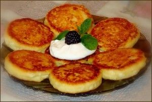 Russian Curd Fritters (Syrniki) Recipe.   I LOVE these.   I buy them at the Russian store in LA.   They have them with raisins or not.   I can't believe I have the recipeeeeeee!!!!!!!!!!